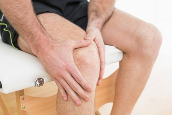 Damage the cartilage in a joint